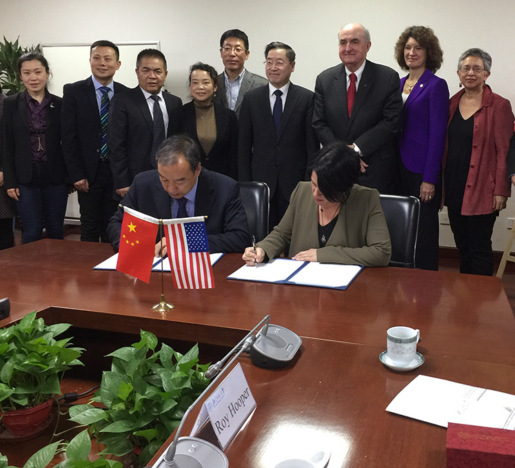 The agreement is signed by BNU Faculty of Education Professor Liu Baocun, Director for the Institute for International Comparative Education (IICE) and Dr. Arlene Benitez, Interim Director for the School of Education's Center for International Education, Development and Research (CIEDR)