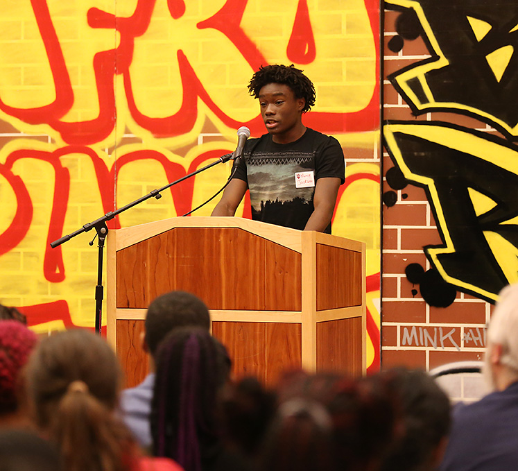 Student Prince Jackson shares his writing at the African-American Read-In
