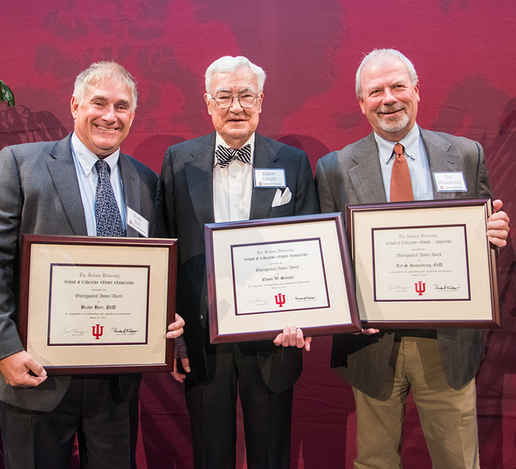 School of Education Distinguished Alumni Award winners, from left, Brady Barr, Edson W. Sample and Ted S. Hasselbring. Saisuree Chutikul was not present at the ceremony; Peter Boonjarern, president of the IU Thailand Alumni Association, presented her award in Thailand.